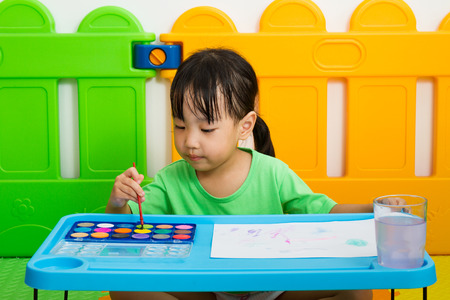 preschooler: Asian Little Chinese Girl Painting with Watercolor at Home