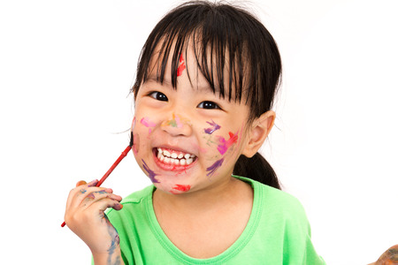 dirty girl: Asian Little Chinese Girl Playing and Painting isolated on White Background Stock Photo