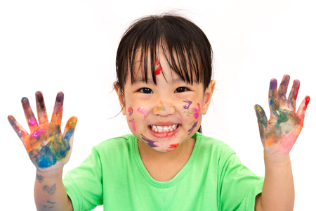 messy: Asian Little Chinese Girl Playing and Painting isolated on White Background Stock Photo