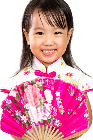 chinese dress: Asian Little Chinese Girl Holding Oriental Fan isolated on White Bakground