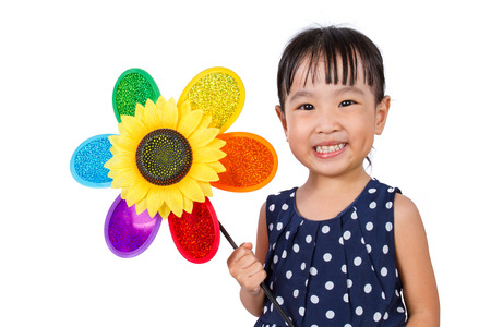 asian children: Asian Little Chinese Girl Holding Colorful Windmill isolated on White Background