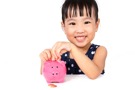 protection plan: Asian Little Chinese Girl Putting Coins into Piggy Bank isloated on White Background