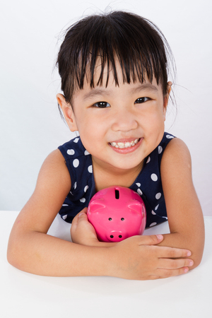 small girl: Asian Little Chinese Girl Hugging Piggy Bank  isolated on White Background Stock Photo