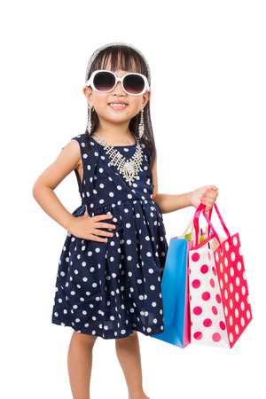 Asian Little Chinese Girl with Shopping Bag isolated on White Background