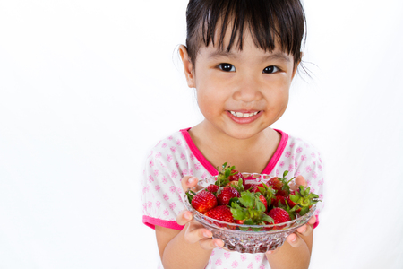 Asian Little Chinese Girl Holding Strawberry isolated on White Background Stock Photo