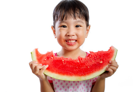 niños sanos: Asian Little Chinese Girl Eating Watermelon isolated on White Background