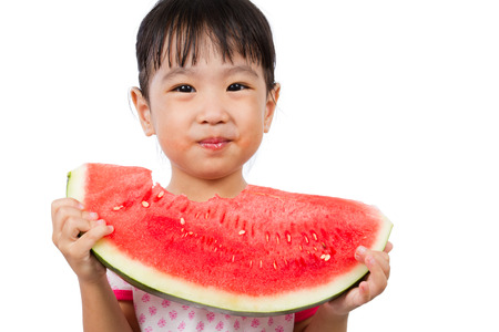 healthy snack: Asian Little Chinese Girl Eating Watermelon isolated on White Background