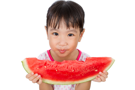 child smile: Asian Little Chinese Girl Eating Watermelon isolated on White Background