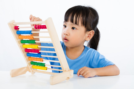 Asian Little Chinese Girl Playing Colorful Abacus isolated on White Background Stock Photo