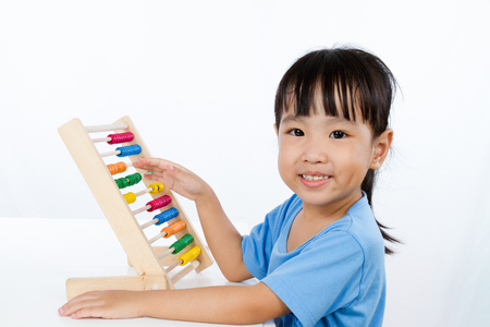 baby isolated: Asian Little Chinese Girl Playing Colorful Abacus isolated on White Background Stock Photo