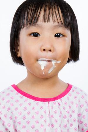 child ice cream: Asian Little Chinese Girl Eating Ice Cream isolated on White Background Stock Photo