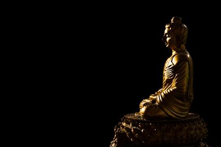 buddhist's: Sitting Bronze Budda in isolated Black Background
