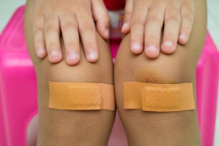 adhesive bandage: Child with plaster on Knee Close Up Stock Photo