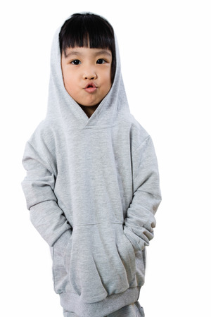 wry: Asian Little Chinese Girl Wearing a Hoodie in isolated White Background