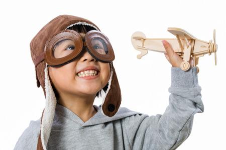 アジア少し中国の女の子で遊んで分離ホワイト バック グラウンドでおもちゃの飛行機 写真素材