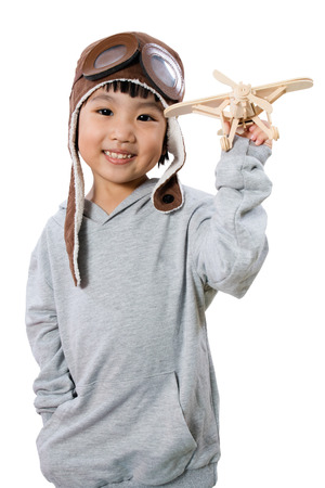 fantasize: Asian Little Chinese Girl Playing with Toy Airplane in isolated White Background