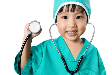 auscultate: Asian Little Chinese Girl Playing a Doctor with Stethoscope in isolated White Background