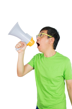 outraged: Asian Chinese Man Shouting with a Megaphone in isolated White Background