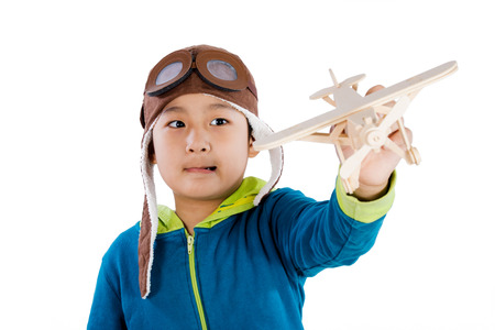 fantasize: Asian Chinese Boy Playing with Wooden Airplane in isolated White Background Stock Photo