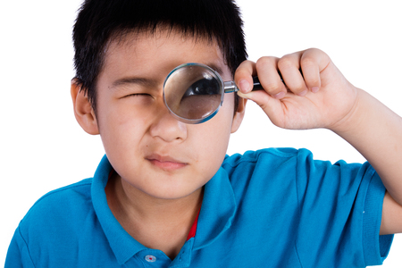 finding: Asian Chinese Boy Holding Magnifying Glass isolated on White Background
