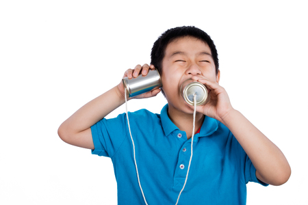 tin can phone: Asian Chinese Boy Playing with Tin Can Phone isolated on White Background Stock Photo