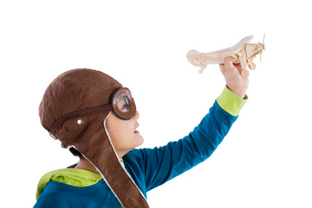 asian boy: Asian Chinese Boy Playing with Wooden Airplane in isolated White Background Stock Photo