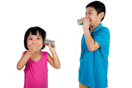 tin can phone: Asian Chinese Kid Playing with Tin Can Phone isolated on White Background Stock Photo