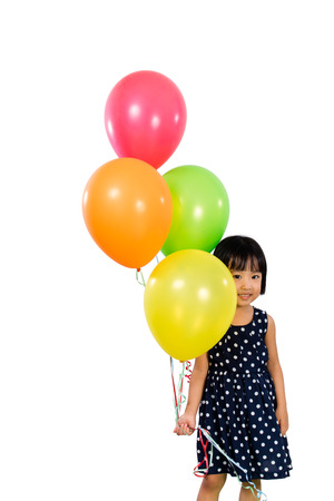 kids background: Asian Little Chinese Girl Holding Colorful Balloons in isolated White Background