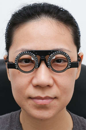 diopter: Asian Woman Doing Eyes Examination at Optics Store