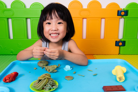 clays: Asian Little Chinese Girl Playing with Colorful Clay in Indoor Playground