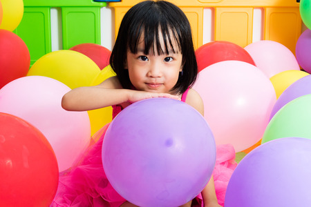 child birthday: Asian Little Chinese Girl Playing with Colorful Balloons in Indoor Playground