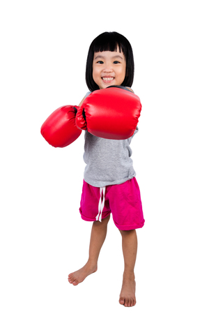 red gloves: Asian Little Chinese Girl Wearing Boxing Glove in isolated white background.