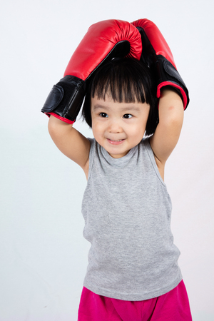 disheartened: Asian Little Chinese Girl Wearing Boxing Glove With Frustration Expression