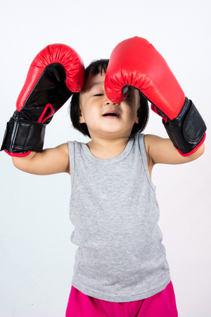 Asian Little Chinese Girl Wearing Boxing Glove With Frustration Expression