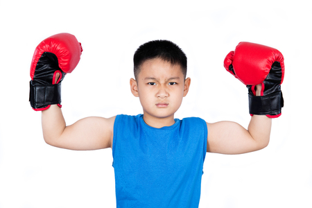 boy boxing: Asian Chinese boy wearing boxing gloves with victory in isolated plain white background. Stock Photo