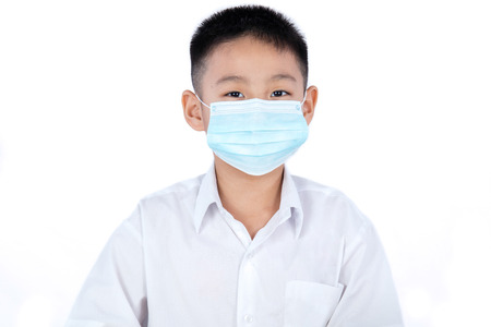 Asian Chinese Student Boy In Uniform Wearing Mask in plain isolated white background.