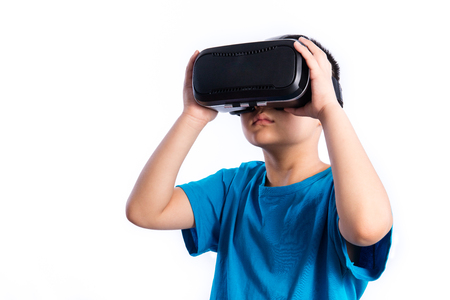 Asian Chinese Little Boy Wearing Virtual Reality Glasses in plain isolated white background.