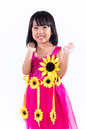 Happy Asian Chinese Liitle Girl In Dancing Custome in isolated white background.