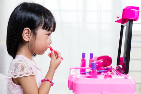 young asian: Asian Chinese Liitle Girl Playing With Make-Up Toys At Home Stock Photo