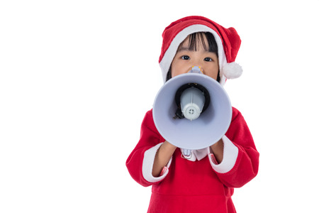 proclaim: Asian Chinese little santa girl holding loudspeaker shouting in isolated white background.