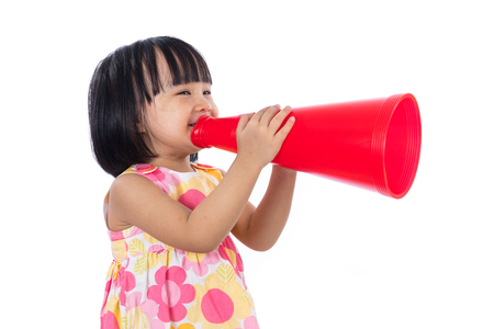 niños chinos: Happy Asian Chinese little girl holding retro loudspeaker in isolated white background.