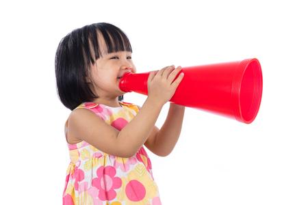 asian children: Happy Asian Chinese little girl holding retro loudspeaker in isolated white background.