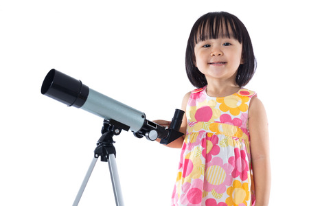 Asian Chinese little girl with telescope in isolated white background.