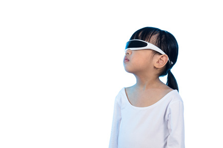 futuristic girl: Asian Chinese little girl wearing futuristic eyeglassses and costumes act as cyborg in isolated background