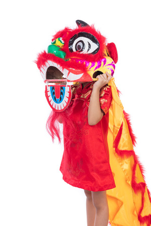 Asian Chinese little girl with Lion Dance costume celebrating Chinese New Year in isolated white background. Stock Photo