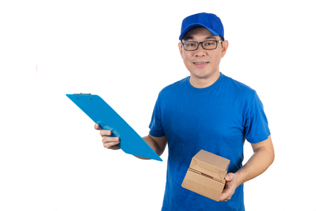 Smart Asian Chinese delivery guy in uniform delivering parcel in isolated white background. Stock Photo