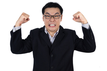 isolated man: Angry Asian Chinese man wearing suit and holding both fist in isolated white background. Stock Photo