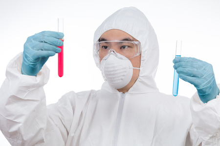 Asian Chinese scientist in protective wear holding test tube in isolated white background. Stock Photo