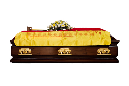A brown Casket at a traditional Chinese funeral services in isolated white background. Stock Photo