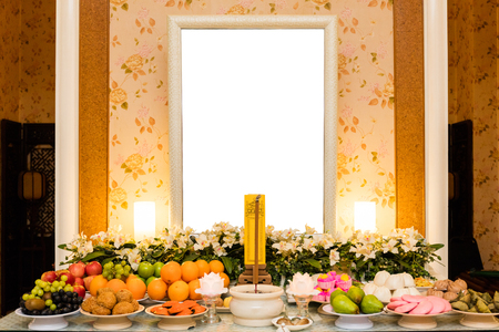 pass away: Traditional Chinese Mourning Hall with blank photo frame and floral and fruit decoration. Stock Photo